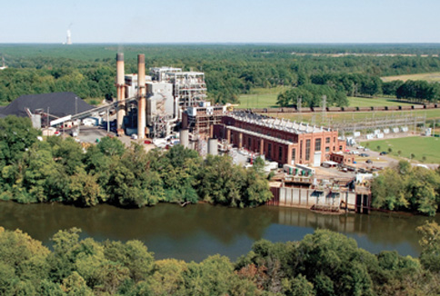 Progress Energy officially retired two coal-fired power plants, including the utility's first coal-fired facility, the Cape Fear plant, built in 1923.