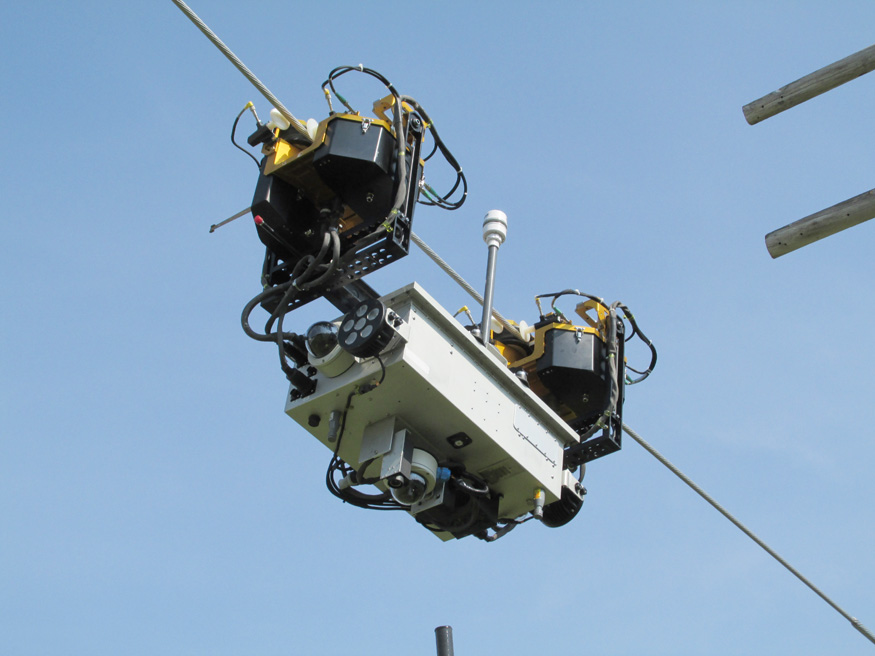 Ti traverses an energized transmission line during a mobility and endurance test run.